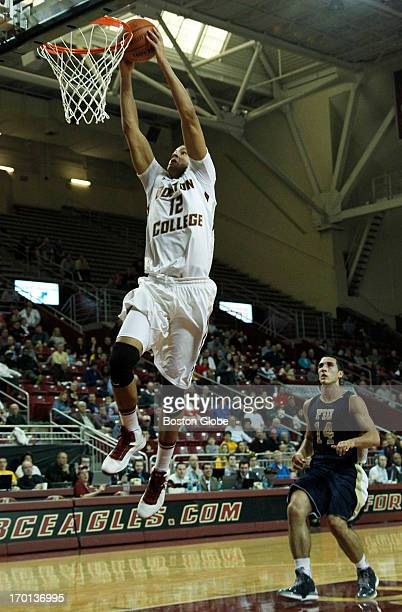 BC forward Ryan Anderson gets a breakaway dunk off an assist by freshman guard Olivier Hanlan in the 1st half Boston College men's basketball plays...