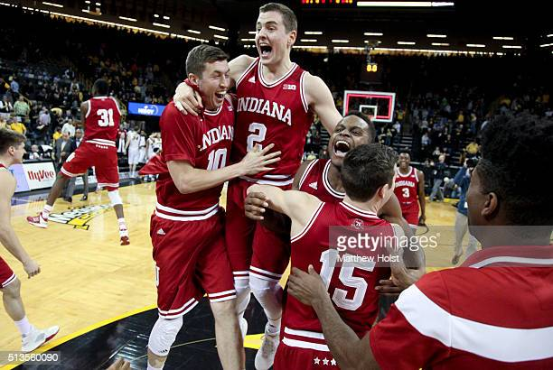 Forward Ryan Buron and guards Nick Zeisloft Kevin 'Yogi' Ferrell and Harrison Niego of the Indiana Hoosiers celebrates with teammates after they...