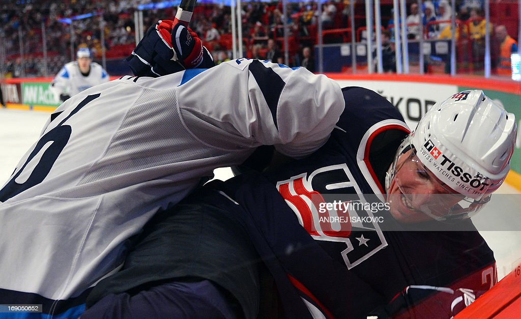 US forward Ryan Carter (R) vies with Finland's defender Janne Jalasvaara during the third place match Finland vs United States of the IIHF International Ice Hockey World Championship at Globe Arena in Stockholm on May 19, 2013.