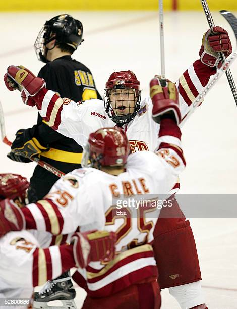 Forward Ryan Dingle of the Denver Pioneers celebrates with teammates after they scored against the Colorado College Tigers on April 7 2005 during the...
