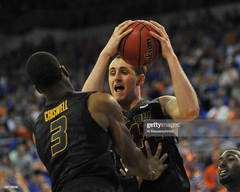 Forward Ryan Rosburg #44 of the Missouri Tigers grabs a rebound against the Florida Gators January 19, 2013 at Stephen C. O'Connell Center in Gainesville, Florida. The Gators won 83 - 52.