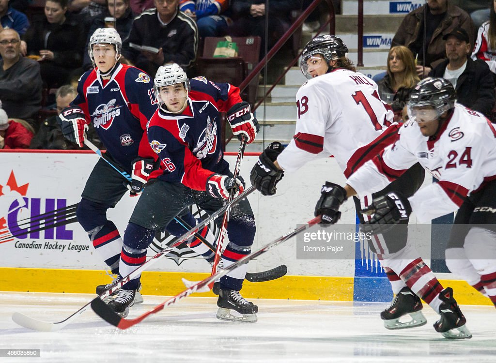 Forward Sam Povorozniouk #26 of the Windsor Spitfires moves the puck against forward Tyler Hill #13 of the Guelph Storm on March 12, 2015 at the WFCU Centre in Windsor, Ontario, Canada.