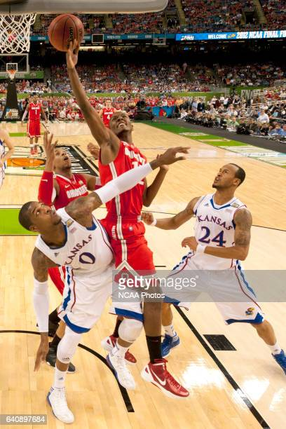 Forward Sam Thompson from Ohio State University spilts the defense of teammates forward Thomas Robinson and guard Travis Releford from the University...