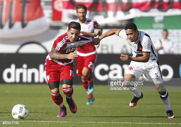 Forward Sebastian Driussi from River Plate of Argentina vies for the ball with right back Yago Pikachu of Brazilian club Vasco da Gamal during their...