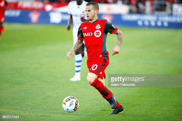 Forward Sebastian Giovinco of Toronto FC pushes the ball forward against the Montreal Impact during Leg 2 of the 2017 Canadian Championship on June...