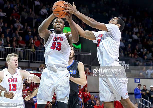SMU forward Semi Ojeleye and guard Sterling Brown go for a rebound during the NCAA men's basketball game between SMU Mustangs and UC Santa Barbara...