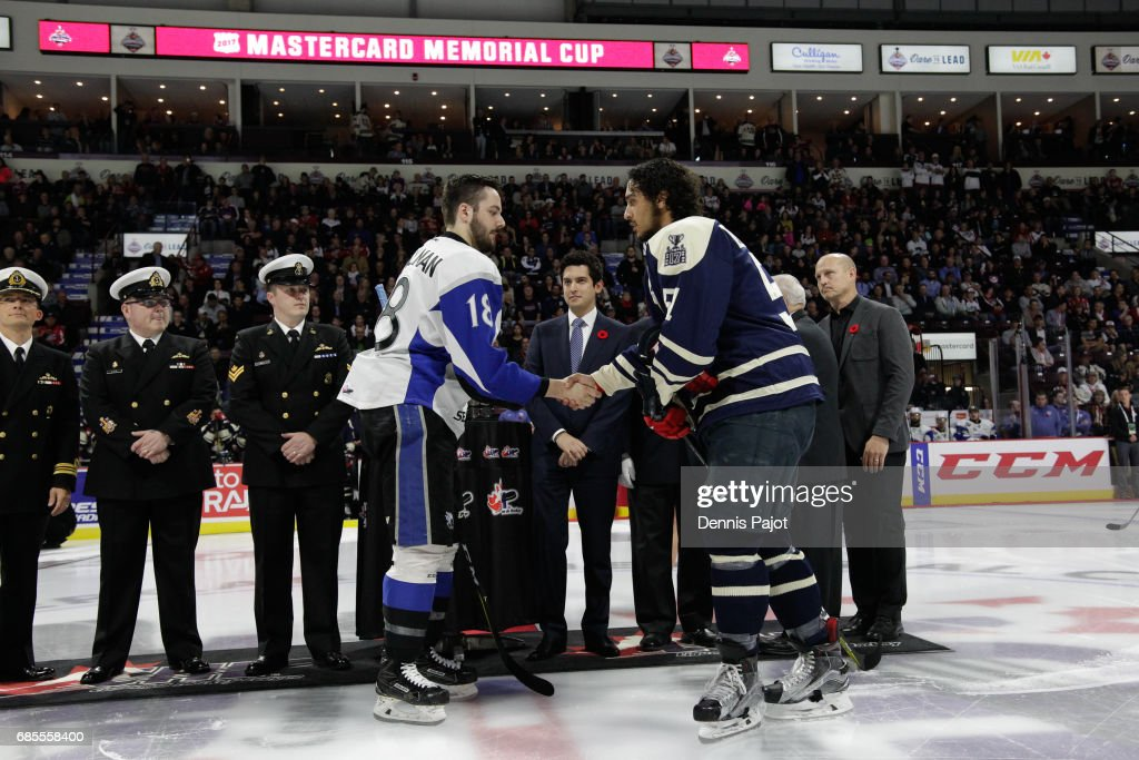 Forward Spencer Smallman #18 of the Saint John Sea Dogs shakes hands with defenceman Jalen Chatfield #51 of the Windsor Spitfires on May 19, 2017 prior to Game 1 of the Mastercard Memorial Cup at the WFCU Centre in Windsor, Ontario, Canada.