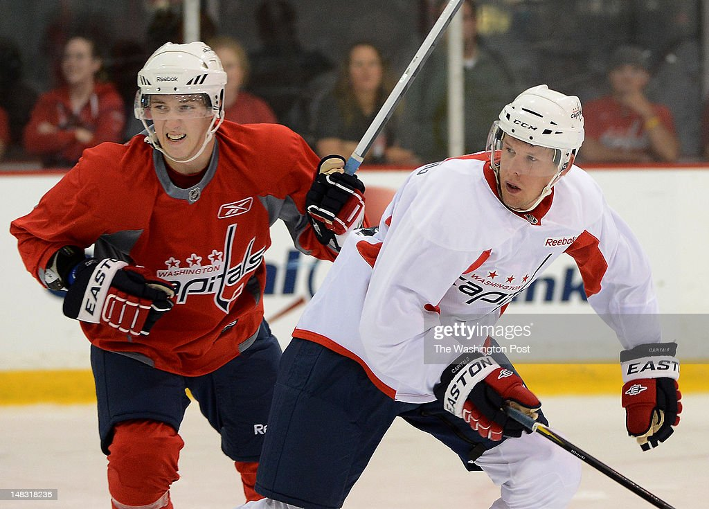 Forward Stanislav Galiev, left, and defenseman Cameron Schilling, right, during a scrimmage as part of the Washington Capitals Player Development Camp at Kettler Iceplex on Tuesday, July 10, 2012.