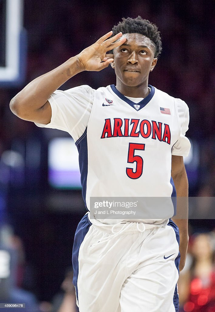 Forward Stanley Johnson of the Arizona Wildcats salutes the Arizona fans during their game against the Cal State Northridge Matadors at McKale Center...