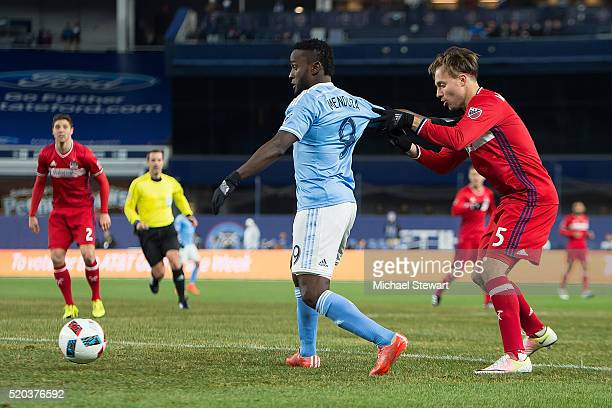 Forward Steven Mendoza of New York City FC and defender Michael Harrington of Chicago Fire vie for the ball during the match at Yankee Stadium on...
