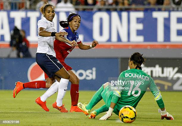 Forward Sydney Leroux of the United States scores a goal against defender Laura Georges of France and goalkeeper Sarah Bouhaddi of France during the...