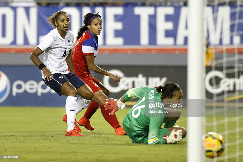 Forward <a gi-track='captionPersonalityLinkClicked' href=/galleries/search?phrase=Sydney+Leroux&family=editorial&specificpeople=5760664 ng-click='$event.stopPropagation()'>Sydney Leroux</a> #2 of the United States scores a goal against defender <a gi-track='captionPersonalityLinkClicked' href=/galleries/search?phrase=Laura+Georges&family=editorial&specificpeople=2333299 ng-click='$event.stopPropagation()'>Laura Georges</a> #4 of France and goalkeeper <a gi-track='captionPersonalityLinkClicked' href=/galleries/search?phrase=Sarah+Bouhaddi&family=editorial&specificpeople=2351270 ng-click='$event.stopPropagation()'>Sarah Bouhaddi</a> #16 of France during the first half of a women's friendly soccer match on June 14, 2014 at Raymond James Stadium in Tampa, Florida.