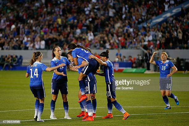 Forward Sydney Leroux of USA jumps on Forward Abby Wambach back and celebrates her goal with the team against Mexico during their international...