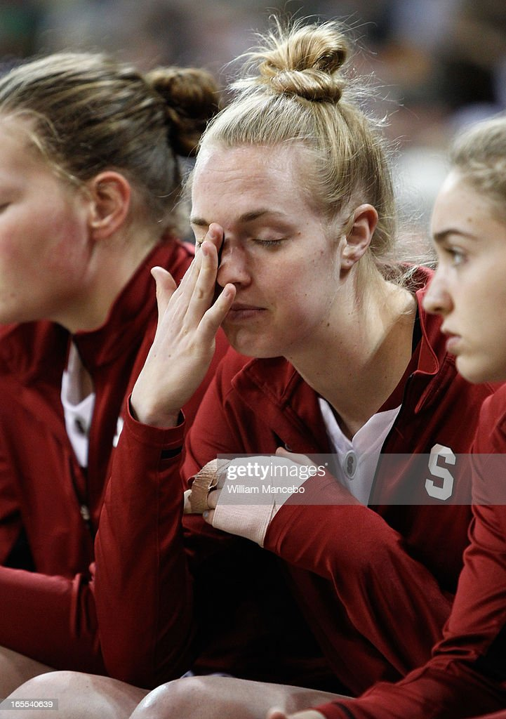 Forward Taylor Greenfield #4 of the Stanford Cardinal is sidelined with a finger injury in the game against the Georgia Lady Bulldogs during the NCAA Division I Women's Basketball Regional Championship at Spokane Arena on March 30, 2013 in Spokane, Washington.