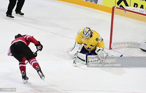 Forward Taylor Hall of Canada shoots to score a penalty shot past goalkeeper Anders Nilsson of Sweden during the group A preliminary round match...