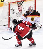 Forward Taylor Hall shoots to score past goalkeeper Danny aus den Birken of Germany during the group A preliminary round ice hockey match Canada vs...