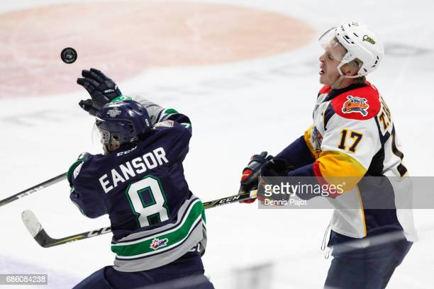 Forward Taylor Raddysh of the Erie Otters battles for the puck against forward Scott Eansor of the Seattle Thunderbirds on May 20 2017 during Game 2...
