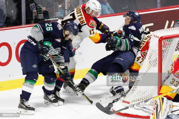 Forward Taylor Raddysh of the Erie Otters places a hit against forward Sami Moilanen of the Seattle Thunderbirds on May 20 2017 during Game 2 of the...