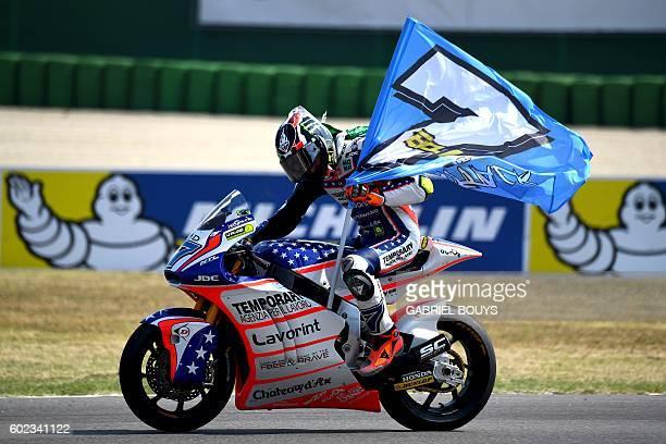 Forward Team Italian rider Lorenzo Baldassarri rides his bikes as he celebrates after winning the Moto2 race of the San Marino Moto GP Grand Prix at...