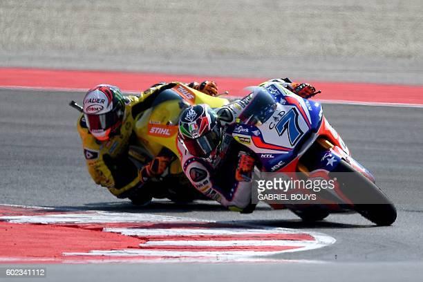 Forward Team Italian rider Lorenzo Baldassarri rides his bikes in front of Paginas Amarillas HP 40 Spanish rider Alex Rins during the Moto2 race of...