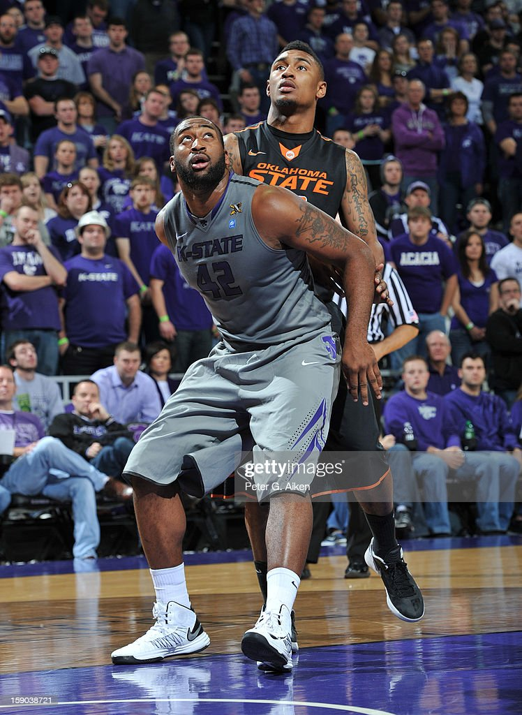 Forward Thomas Gipson #42 of the Kansas State Wildcats gets set for a rebound with guard Le'Bryan Nash #2 of the Oklahoma State Cowboys during the second half on January 5, 2013 at Bramlage Coliseum in Manhattan, Kansas.