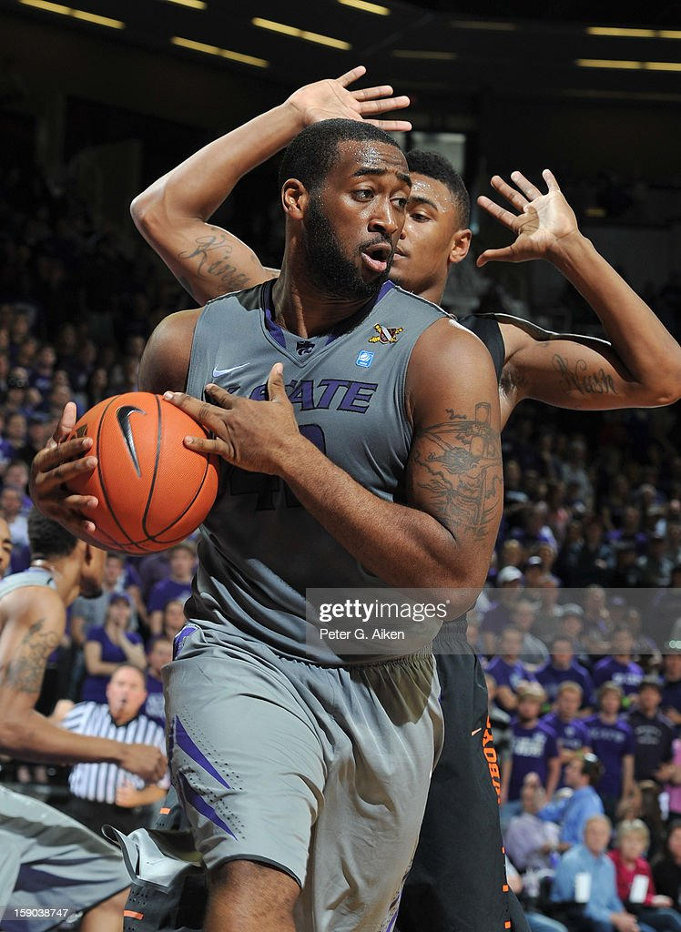 Forward Thomas Gipson #42 of the Kansas State Wildcats pulls away a defensive rebound against the Oklahoma State Cowboys during the first half on January 5, 2013 at Bramlage Coliseum in Manhattan, Kansas.