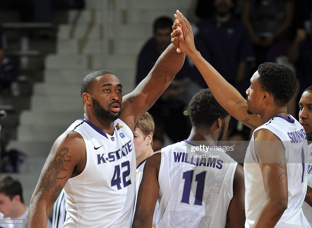 Forward Thomas Gipson #42 of the Kansas State Wildcats reacts after scoring with teammate Shane Southwell #1 against the Missouri-Kansas City Kangaroos during the first half on December 29, 2012 at Bramlage Coliseum in Manhattan, Kansas.
