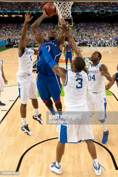 Forward Thomas Robinson from the University of Kansas puts up a shot attempt in front of guard Darius Miller forward Michael KiddGilchrist and...