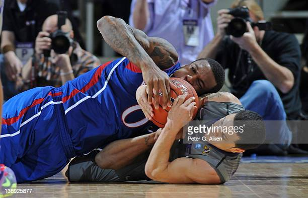 Forward Thomas Robinson of the Kansas Jayhawks battles for the ball with guard Angel Rodriguez of the Kansas State Wildcats during the second half on...