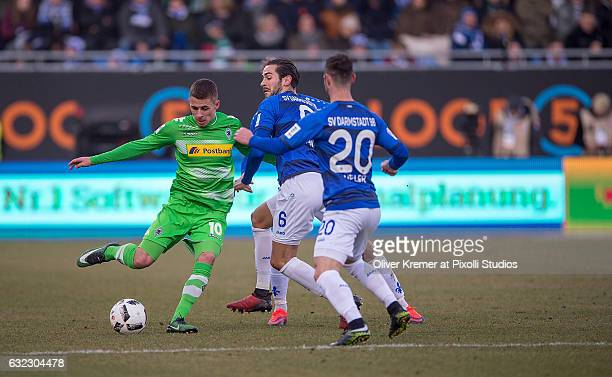 Forward Thorgan Hazard of Borussia Moenchengladbach trying to score while Midfielder Mario Vrancic of SV Darmstadt 98 and Midfielder Marcel Heller of...