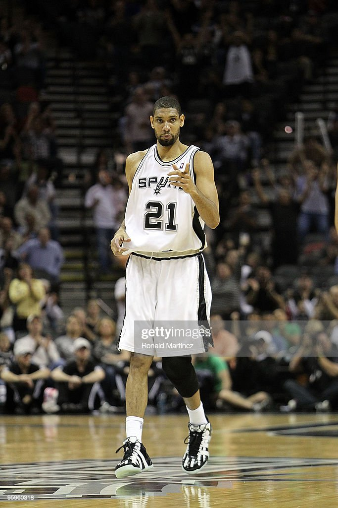 Forward <a gi-track='captionPersonalityLinkClicked' href=/galleries/search?phrase=Tim+Duncan&family=editorial&specificpeople=201467 ng-click='$event.stopPropagation()'>Tim Duncan</a> #21 of the San Antonio Spurs reacts after making his 20,000 career point against the Houston Rockets at AT&T Center on January 22, 2010 in San Antonio, Texas.