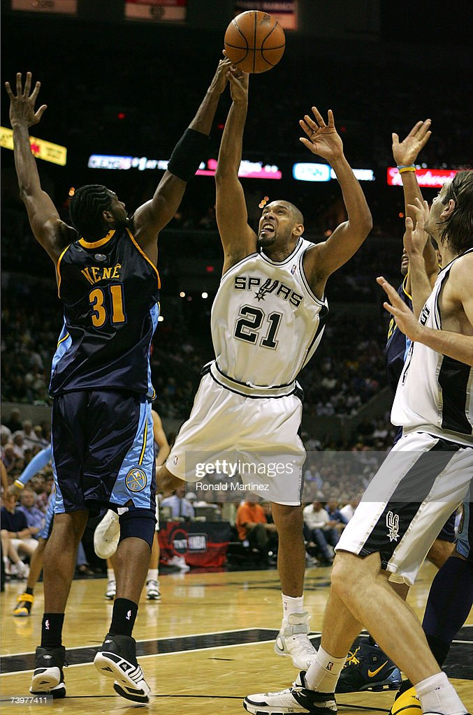 Forward Tim Duncan #21 of the San Antonio Spurs takes a shot Nene #31 of the Denver Nuggets in Game Two of the Western Conference Quarterfinals during the 2007 NBA Playoffs on April 25, 2007 at AT&T Center in San Antonio, Texas. The Spurs defeated the Nuggets 97-88 to tie the series 1-1.