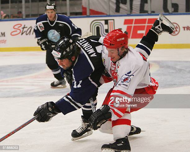 Forward Tony Amonte of the Primus Worldstars is upended by forward Marcin Jaros of the Polish National Team on December 22 2004 at the Spodek Arena...