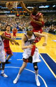 Forward Tracy McGrady of the Houston Rockets makes the slam dunk on top of Shawn Bradley of the Dallas Mavericks in Game two of the Western...