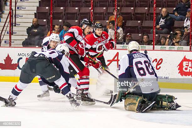Forward Travis Barron of the Ottawa 67's fires the puck against goaltender Michael Giugovaz of the Windsor Spitfires on October 15 2015 at the WFCU...