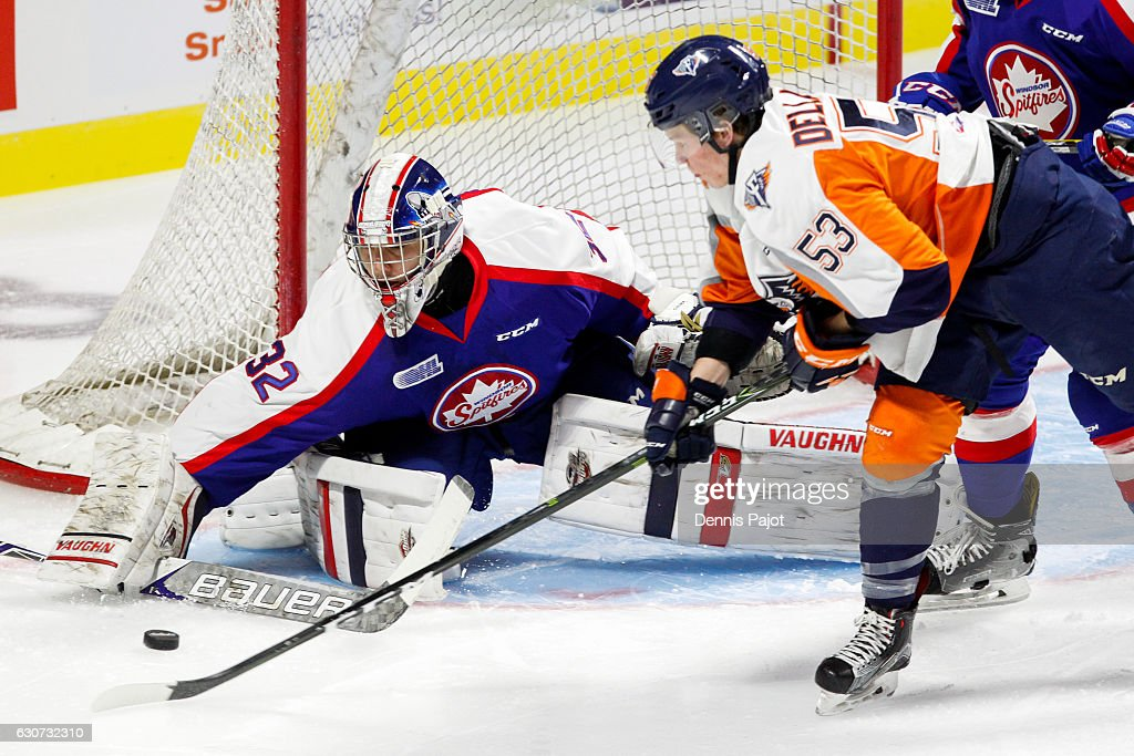 Forward Ty Dellandrea #53 of the Flint Firebirds moves the puck against goaltender Mario Culina #32 of the Windsor Spitfires on December 31, 2016 at the WFCU Centre in Windsor, Ontario, Canada.
