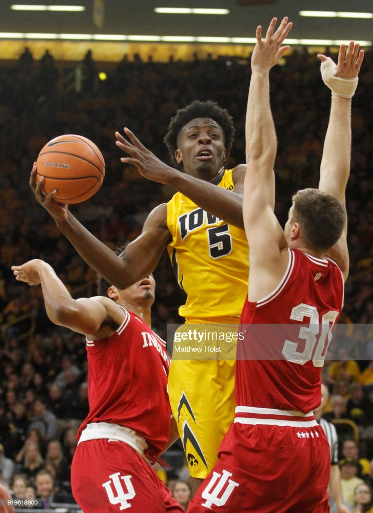 Forward Tyler Cook #5 of the Iowa Hawkeyes goes to the basket during the first half between forwards Justin Smith #3 and Collin Hartman #30 of the Indiana Hoosiers on February 17, 2018 at Carver-Hawkeye Arena, in Iowa City, Iowa.