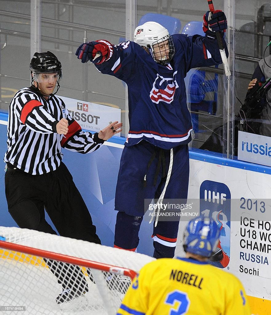 US forward Tyler Motte celebrates scoring against team Sweden during a quarter-final game of the IIHF U18 International Ice Hockey World Championship in Sochi on April 25, 2013.