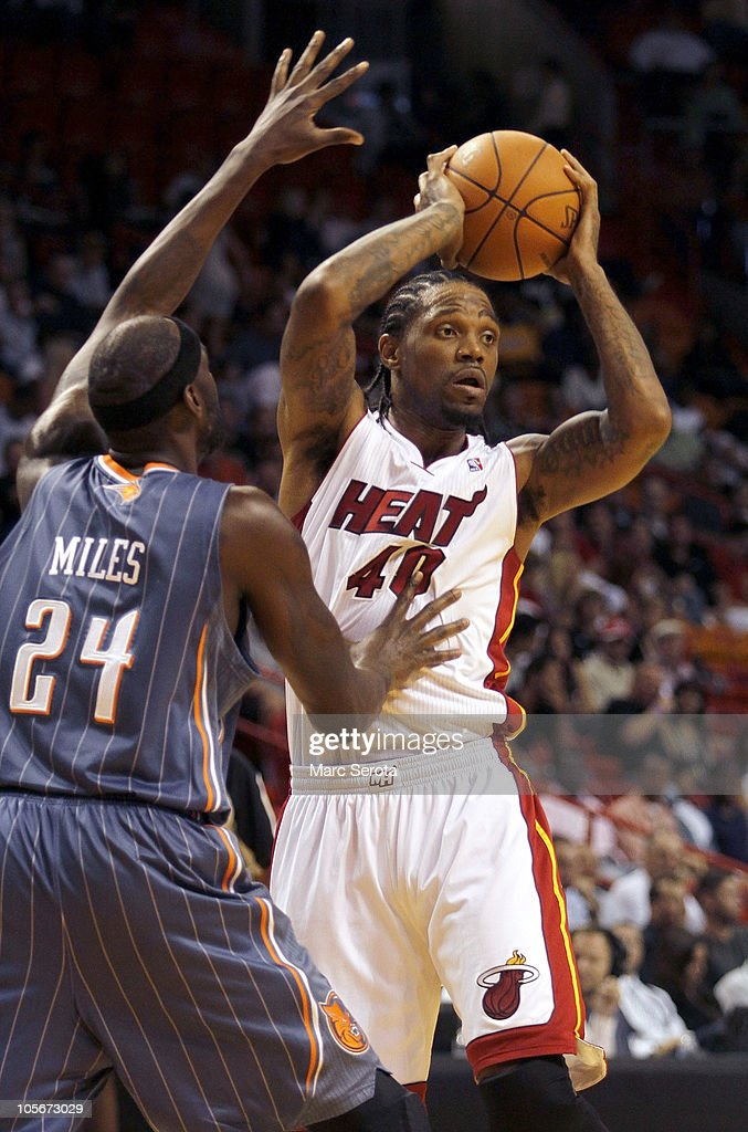 Forward Udonis Haslam #40 of the Miami Heat looks to pass against Forward <a gi-track='captionPersonalityLinkClicked' href=/galleries/search?phrase=Darius+Miles&family=editorial&specificpeople=201702 ng-click='$event.stopPropagation()'>Darius Miles</a> #24 of the Charlotte Bobcats on October 18, 2010 at American Airlines Arena in Miami, Florida.