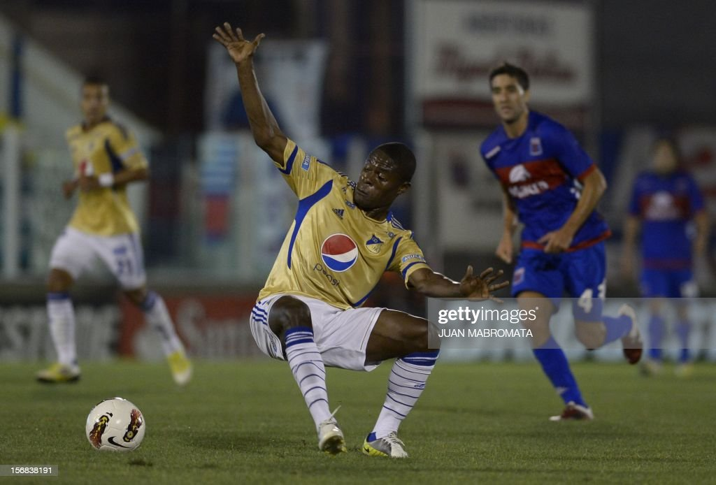 Forward Wilberto Cosme, of Colombia's team Millonarios, eyes the ball after failing to control it during the Copa Sudamericana semifinal first leg match against Argentina's Tigre, in Tigre, Buenos Aires province, Argentina, on November 22, 2012. AFP PHOTO / Juan Mabromata