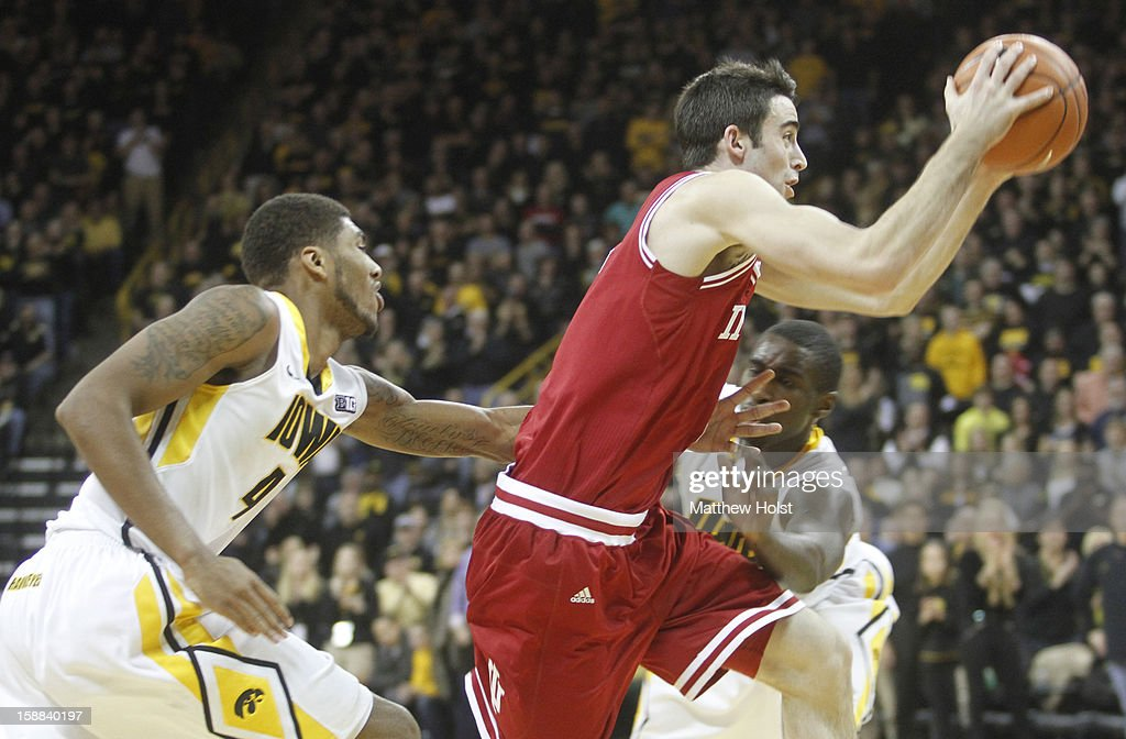 Forward Will Sheehery #0 of the Indiana Hoosiers drives down the court during the second half between guards Roy Devyn Marble #4 and Anthony Clemmons #5 on December 31, 2012 at Carver-Hawkeye Arena in Iowa City, Iowa. Indiana won 69-65.