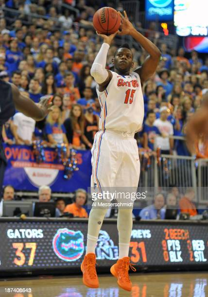 Forward Will Yeguete of the Florida Gators gets set for a shot against the North Florida Ospreys November 8 2013 at the Stephen C O'Connell Center in...