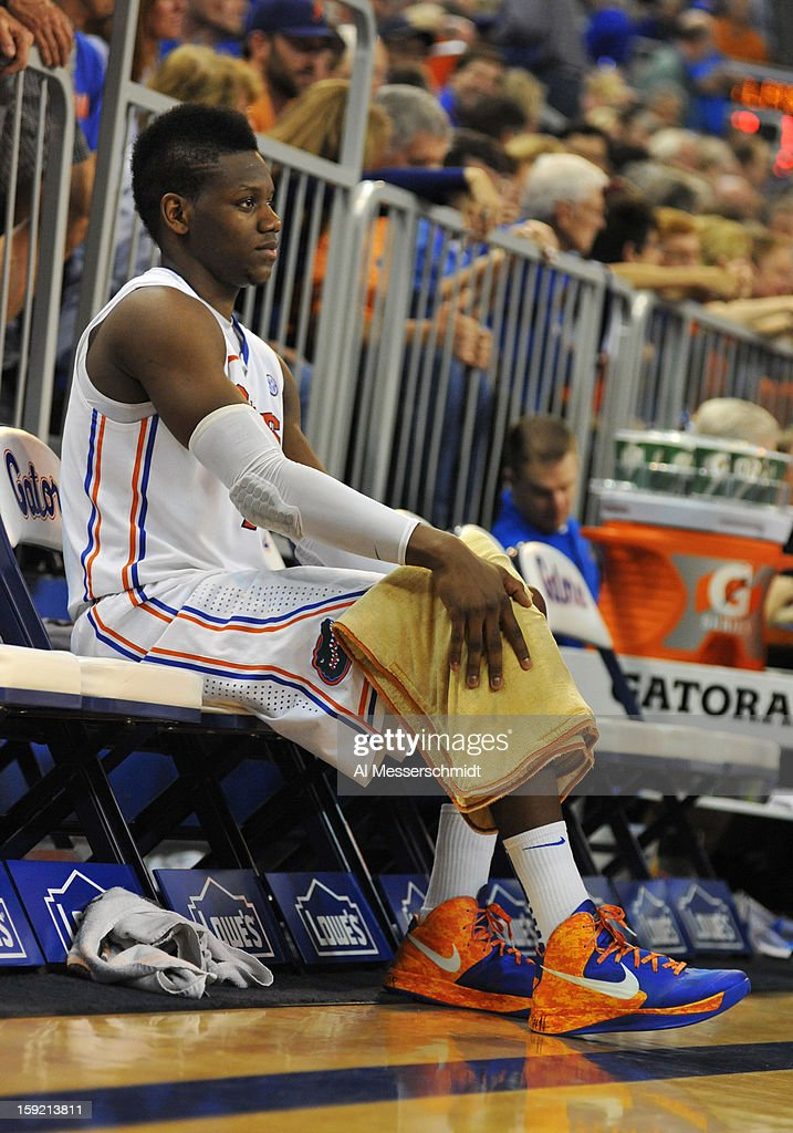 Forward Will Yeguete #15 of the Florida Gators rests an injured knee in the second half against the Georgia Bulldogs January 9, 2013 at Stephen C. O'Connell Center in Gainesville, Florida. Florida won 77 - 44.