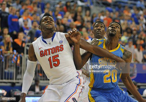 Forward Will Yeguete of the Florida Gators sets for a rebound against forward Calvin Godfrey of the Southern Jaguars November 18 2013 at the Stephen...