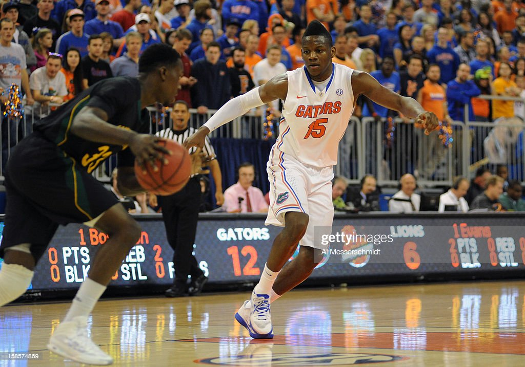 Forward Will Yeguete #15 of the Florida Gators sets on defense against the Southeastern Louisiana Lions December 19, 2012 at Stephen C. O'Connell Center in Gainesville, Florida. Florida won 82 - 43.
