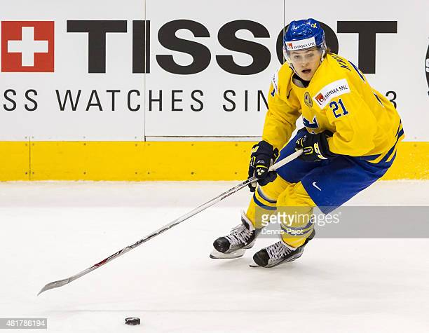 Forward William Nylander of Sweden moves the puck against Slovakia during the Bronze medal game of the 2015 IIHF World Junior Championship on January...