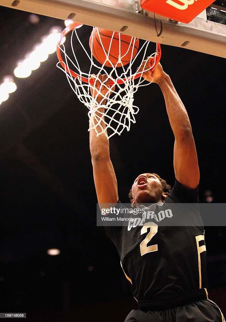Forward Xavier Johnson #2 of the Colorado Buffaloes goes up for a dunk shot during the second half of the game against the Washington State Cougars at Beasley Coliseum on January 19, 2013 in Pullman, Washington.