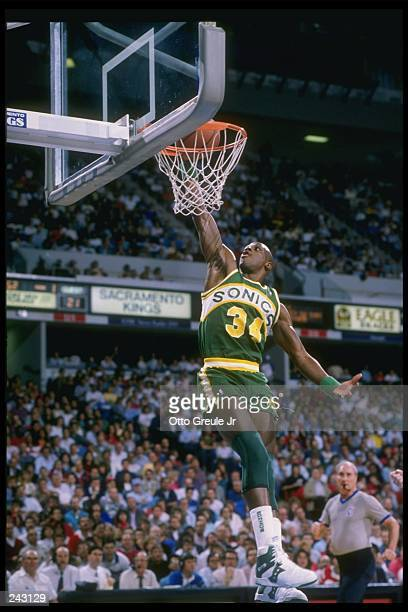 Forward Xavier McDaniel of the Seattle Supersonics goes up for two during a game against the Sacramento Kings at the ARCO Arena in Sacramento...