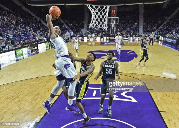 Forward Xavier Sneed of the Kansas State Wildcats drives to the basket against the Northern Arizona Lumberjacks during the first half on November 20...