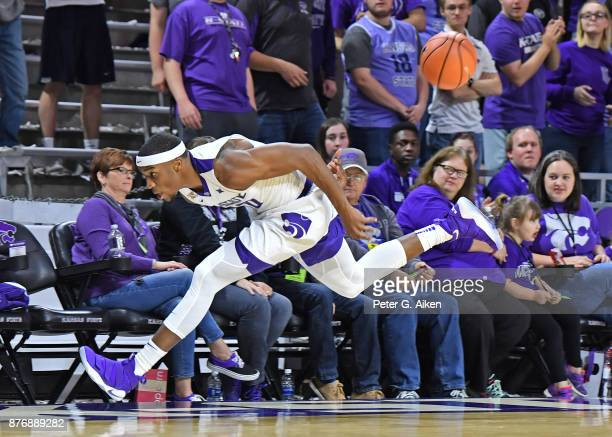 Forward Xavier Sneed of the Kansas State Wildcats passes the ball behind his back before going out of bounds against the Northern Arizona Lumberjacks...